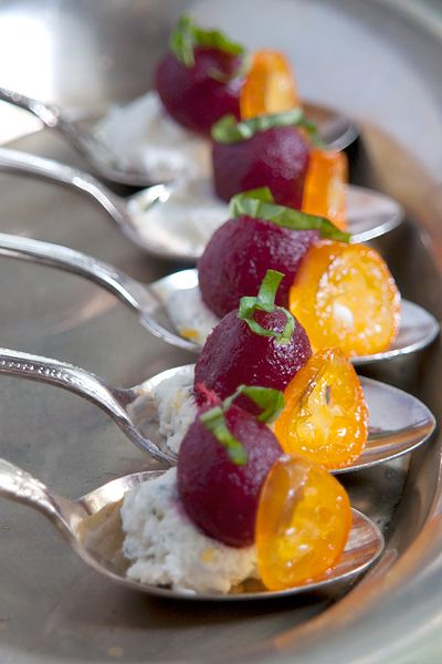 An amuse bouche featuring Aunt Nellie's Pickled Baby Beets with herbed goat cheese and candied kumquats.