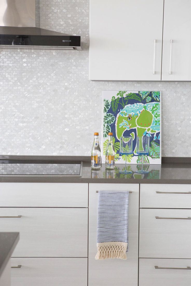 90 best backsplash tile ideas images on pinterest tile ideas artistic tile i this north beach fl oceanside retreat combines nautical elements with our stunning mother of pearl rivershell ovals mosaic backsplash dailygadgetfo Images