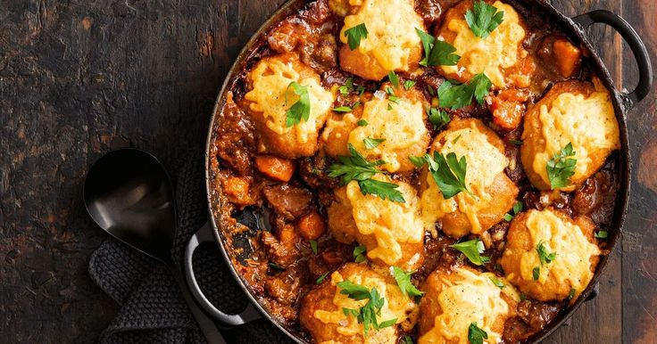 A hearty beef and red wine stew is hard to beat, particularly when it's topped with cheesy, fluffy dumplings.