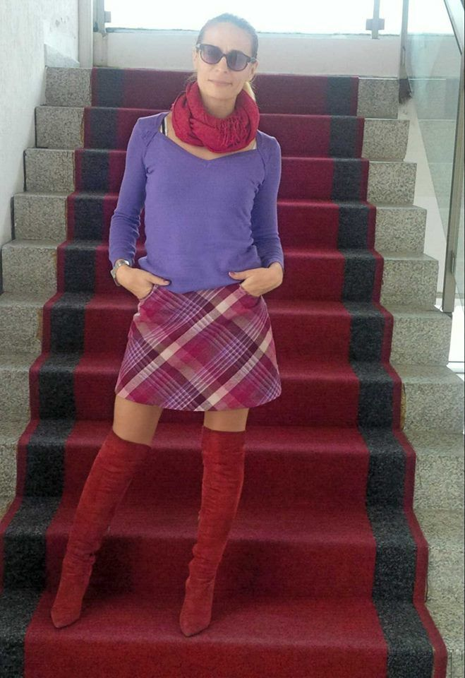 Plaid skirt, overknee boots and purple colors on red carpet.