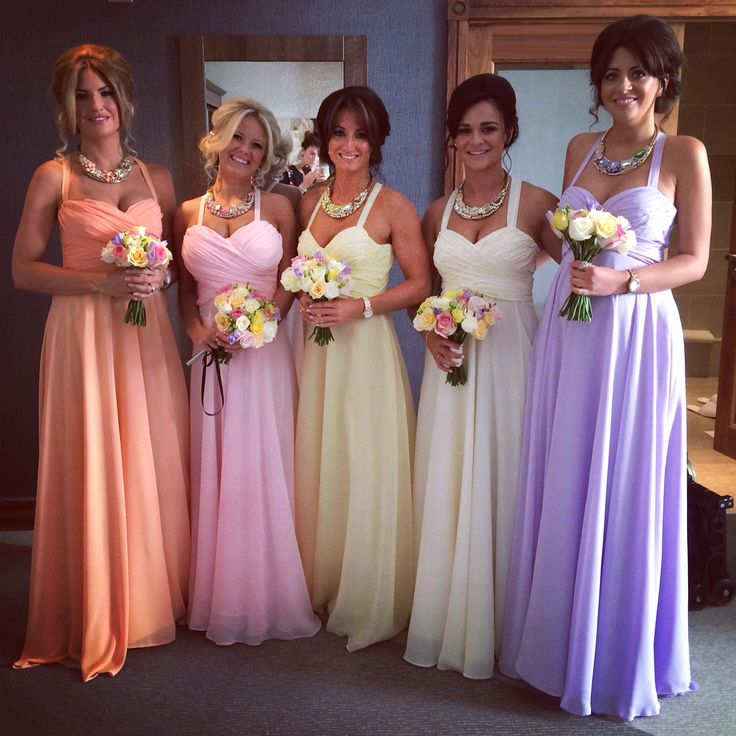 Kirsty Doyle bespoke bridesmaids in an assortment of pastel shades. Grace wanted each girl in the same dress but different colours.  #kirstydoyle #bespoke #bridesmaids