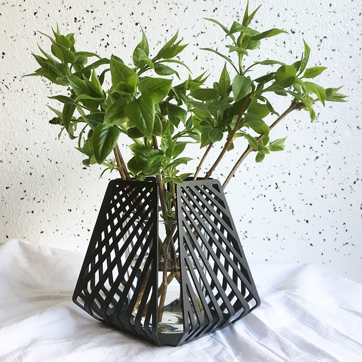 candle holder transformed into vase, styled with green branches picked in the wild