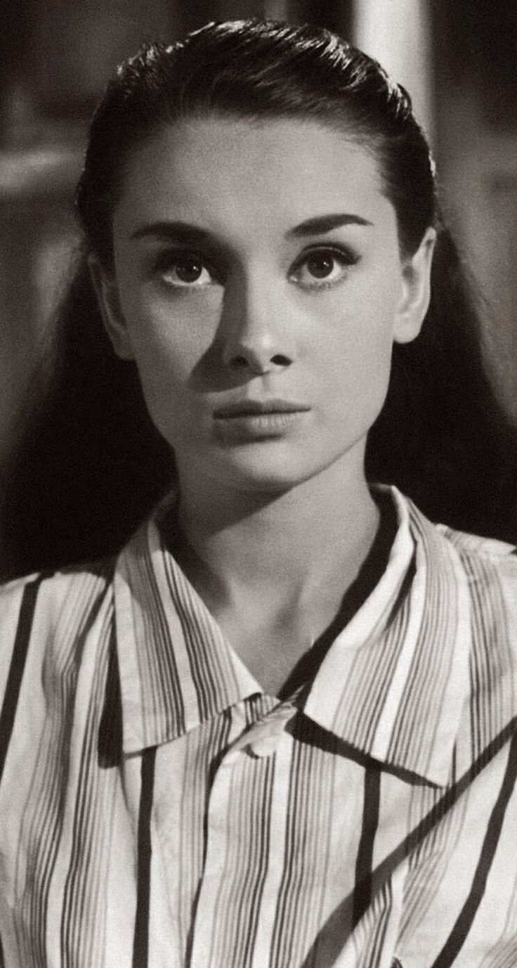 Audrey Hepburn...it's rare to see her with long hair...she looked beautiful no matter her hair though.  : )