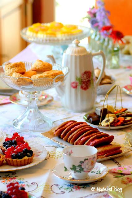 Madelief - tarts, fruits, cookies, and flowers add color and style to the tea table.