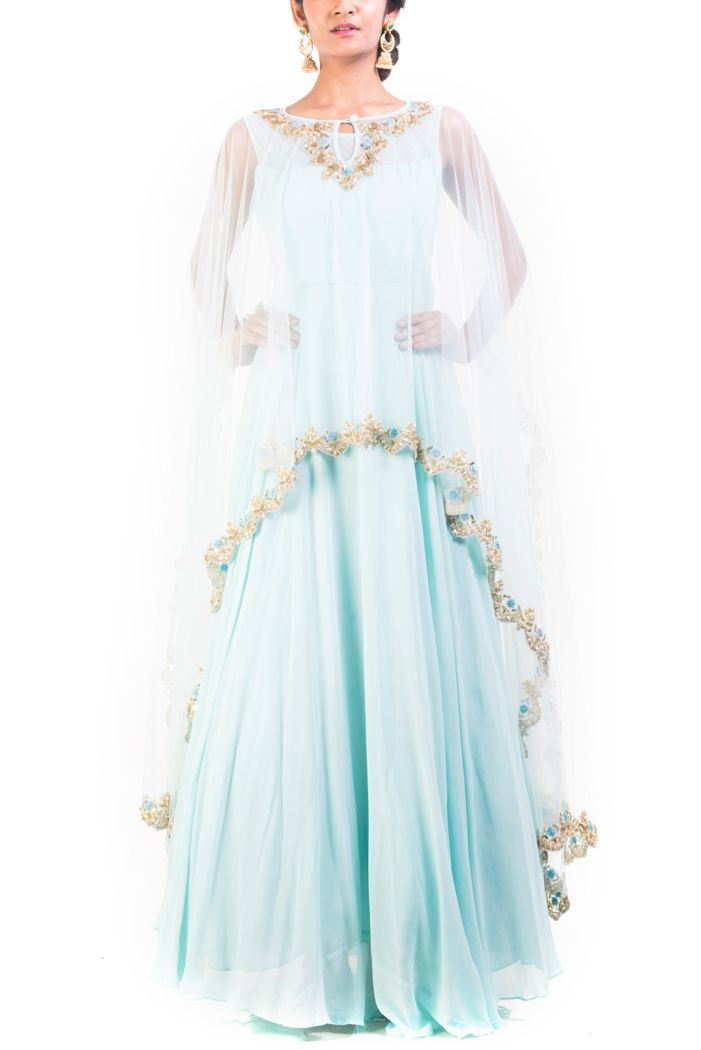 Featuring an embroidered honeydew gown with cape. The cape, beutifully embroidered using thread work, sequins and pearls, embellishes the gown.