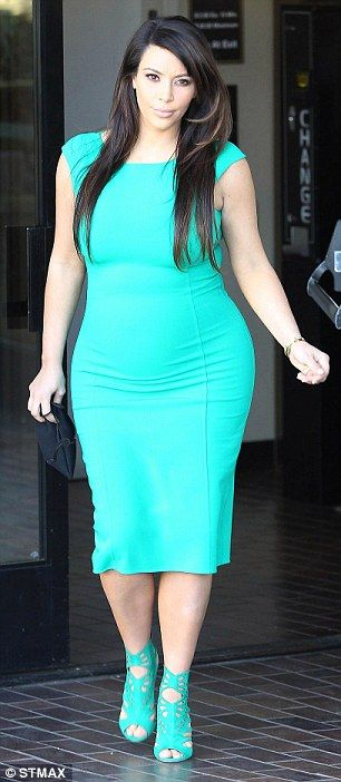 Glamorous: Kim Kardashian, seen here in April, has not shied away from wearing tight-fitting clothes while pregnant...I dk how she did it!