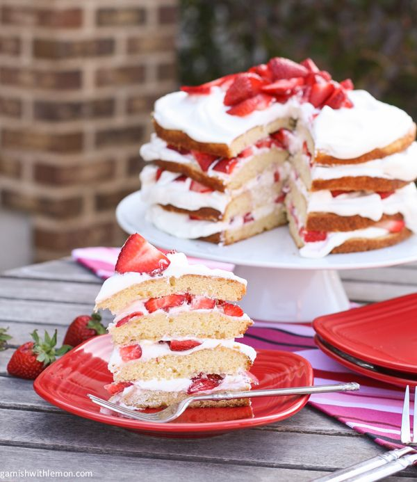 Strawberry Layer Cake- A pound like cake layered with fresh strawberries and whipped cream.