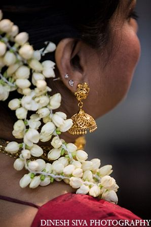 This Indian bride and groom pose for photos at their traditional Hindu wedding ceremony.