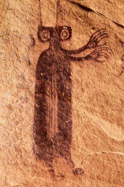 Dominant B.C.S. Anthropomorph Closeup, Supplication Panel, San Rafael Swell, Emery County, Utah (by Jon Bailey.)