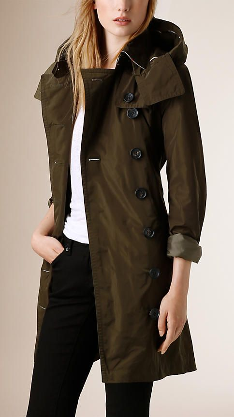 Burberry Dark Olive Hooded Showerproof Trench Coat - A lightweight trench coat crafted from technical showerproof fabric with a detachable hood. Epaulettes, button-tab cuffs, a protective throat latch and a storm shield reference the original Burberry trench coat. Discover the women's outerwear collection at Burberry.com