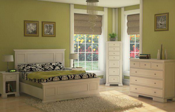 gemütliches schlafzimmer mit grünen wänden