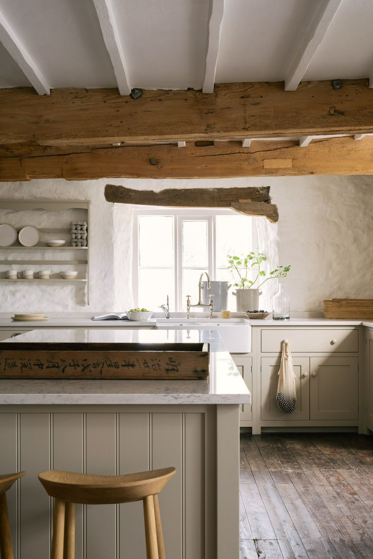 Shaker style with tongue and groove panelling, Silestone worktops and beautifully simple deVOL cupboards.