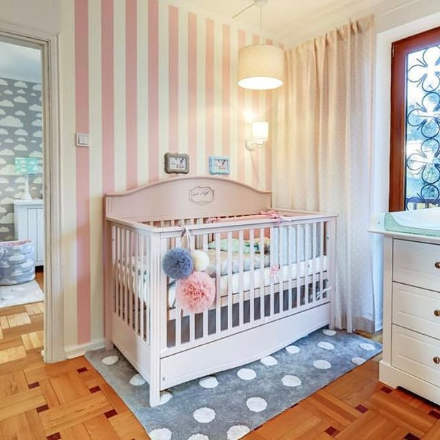 Classic Pink Nursery for a Girl with grey rug and pink wallpaper #nurserydecor #nursery #pink #babygirl #girl #stripes #wallpaper #crib #cot #junior #toddler to see cribhttps://funique.co.uk/pink-cot-bed-70-140-convertible-to-sofa.html