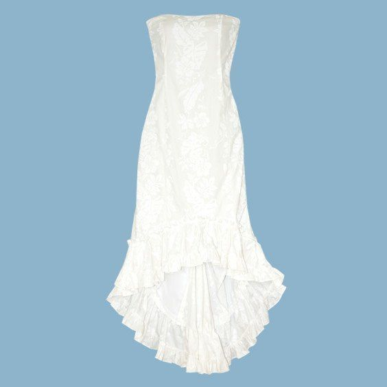 We love this beach wedding dress. Isn't it gorgeous? With it's pretty sweetheart neckline, romantic ruffled fishtail hemline & flattering shape sewn in a white on white Hawaiian fabric. The Momi wedding dress is fully lined with a center back zipper. @ Alohaz