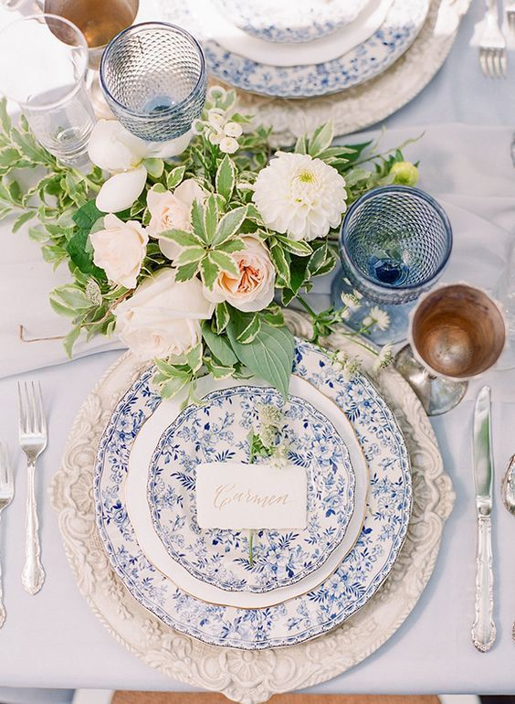 Vintage plates and silverware lend an heirloom quality to this English countryside-inspired wedding.