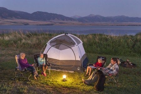 5 Keys to a Fun Family Vacation for Under $1,000 Family camping on the banks of Lake Ennis in southern Montana.