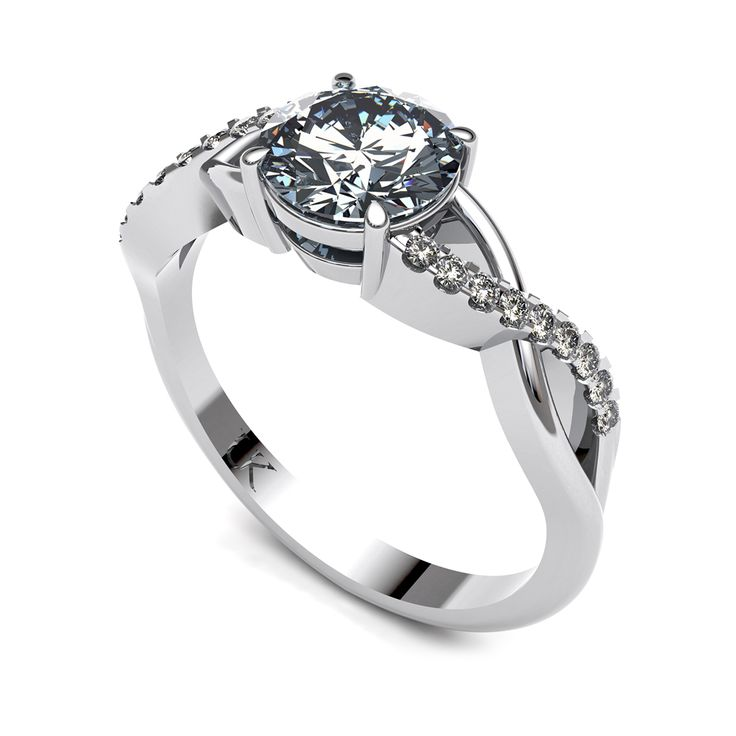 Diamond solitaire ring with twisted diamond band.    www.uwekoetter.com