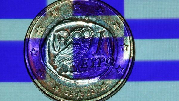 Greek flag projected onto a Greek one euro coin
