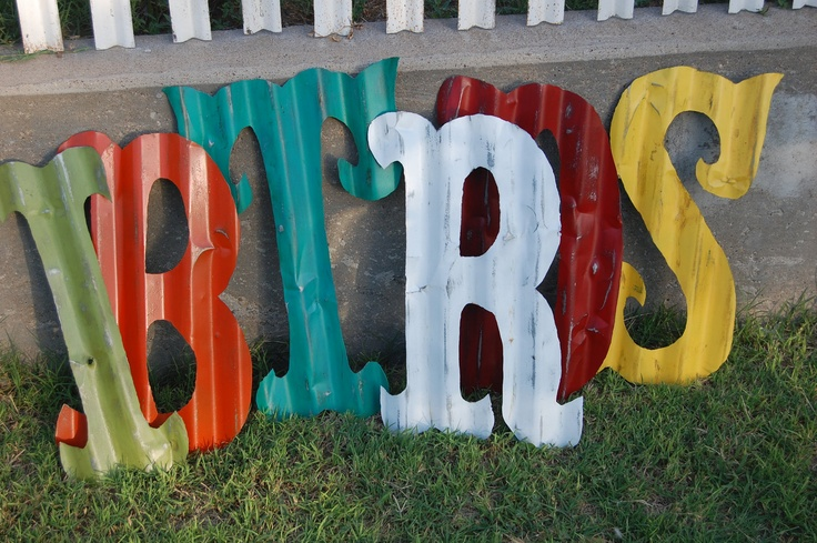 Painted Metal Letters Use old siding or the skirt that goes around a trailer