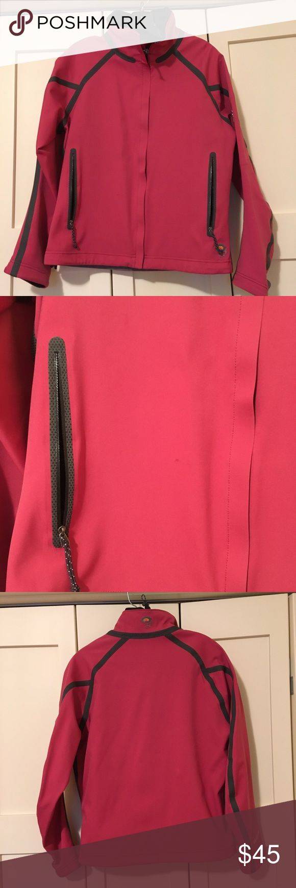 Mountain Hardwear Softshell Jacket Great Mountain Hardwear Conduit Softshell in Size 8. Pinkish/red color. Only worn a few times. Water resistant and a light but warm layer. Small faint mark that may wash out. See close up. Mountain Hardwear Jackets & Coats