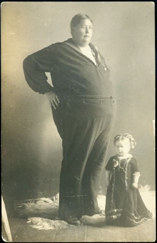 A Fat Man and a Little Woman  real photograph postcard, 5.25 x 3.25 inches, circa 1910  photographer: unknown