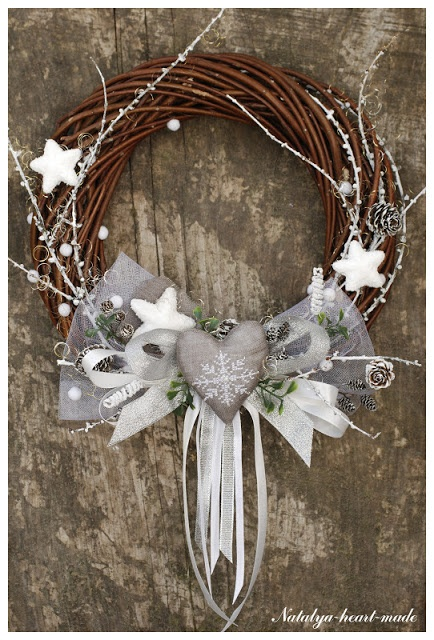 Branches colored white and silver, ribbons, tulle, pine cones and stars in…