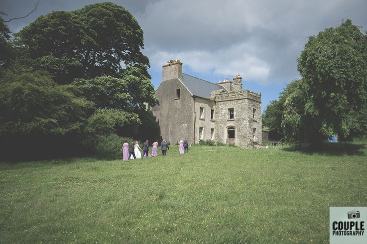 This beautiful old historic house was a gorgeous backdrop for wedding photos. Weddings in Mayo, Photographed by Couple Photography.