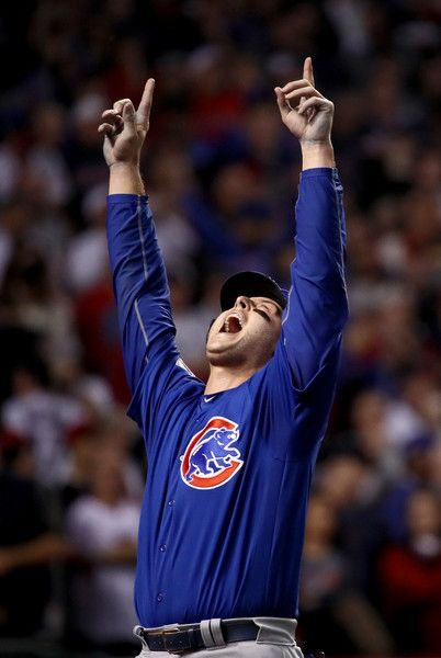 Anthony Rizzo #44 of the Chicago Cubs celebrates after Rizzo scores a run in the 10th inning on a Miguel Montero #47 against the Cleveland Indians in Game Seven of the 2016 World Series at Progressive Field on November 2, 2016 in Cleveland, Ohio.