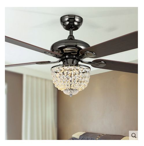 This kind of dark fan with chandelier lights is what I want hanging in the kitchen breakfast area!