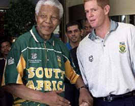 Former Proteas skipper Shaun Pollock sharing a special moment with Madiba