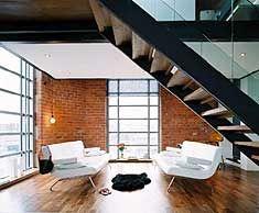 timber mezzanine with exposed brick