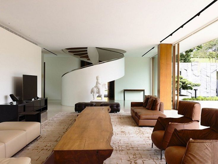 Deco living room with wood table. Architizer.