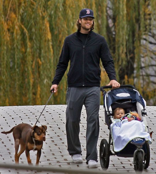 Brady + Rescue Puppy + Baby + Sox hat = we can't even handle it.   Tom Brady walks his dog Lua and his toddler Benjamin along the Charles River Tuesday afternoon, November 16,2010. Staff photo by Mark Garfin...