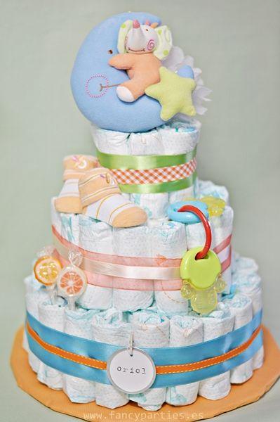 Orange, Blue and Green Modern Diaper Cake by www.fancyparties.es #diapercake #diaper #newborngift