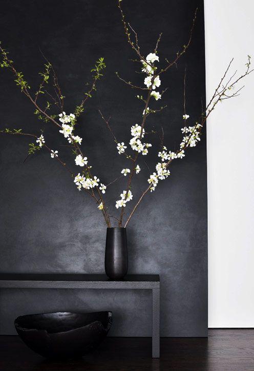 White apple blossoms, black vase