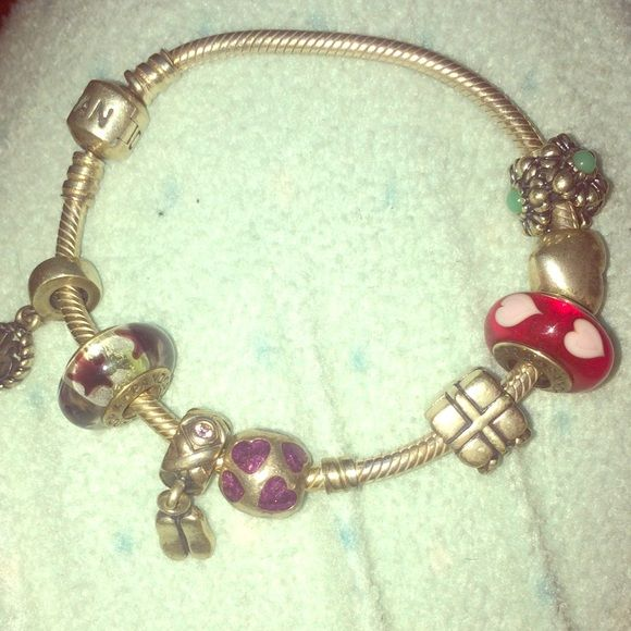 Pandora bracelet with charms Pandora charms! Price is depending on which ones you would like. I have the sweet 16 charm, present charm, ballet charm, heart charm etc. Pandora Jewelry Bracelets
