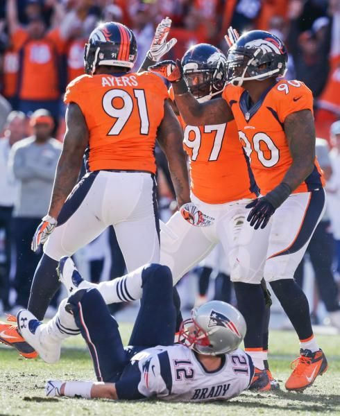 Denver Broncos defensive end Robert Ayers (91) is congratulated by his teammates Malik Jackson (97) and Shaun Phillips (90) after sacking New England Patriots quarterback Tom Brady (12) during the first half. (Julie Jacobson/AP)