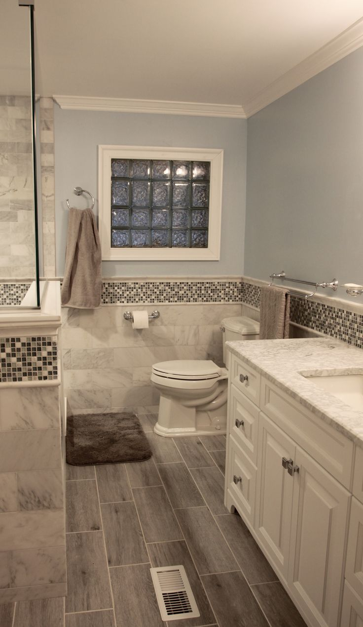 Bathroom tiles mosaic border - Master Bathroom With Faux Wood Tile Marble Tile Mosaic Border And White Vanity In