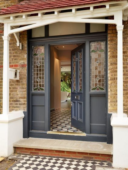 "Traditional Entry by bulthaup by Kitchen ArchitecturePaneled doors with art nouveau glass. ""The front doors of Edwardian homes are always really interesting,"" Parinchy says. Hayes identifies Masonic doors — wooden doors with carvings above, either in stone or wood, usually with"