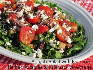 Arugula salad with pan-fried herbed potatoes, cherry tomatoes, feta cheese, and kalamata olive vinaigrette by Farmgirl Susan, via Flickr