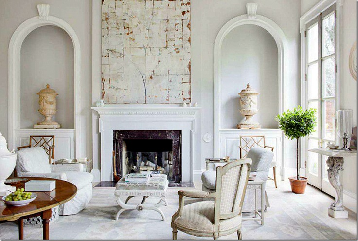 I love the mix of symmetry and asymmetry. It makes the room so interesting. And also the mix of very large and very small objects. It just grabs you!