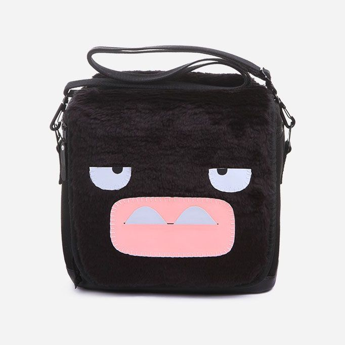 Camera Bag Mr Bootha by Peppercorns. Meet Mr. Bootha, a grumpy monster from the land of Peppercorns! This grouchy Peppercorns Camera Bag Mr Bootha is a great choice of monster for protecting your DSLR. Mr. Bootha's grumpy monster expression is handmade from synthetic leather that is stitched and glued on faux fur. This bag comes complete with an additional divider for lens and accessories, so everything is easy to find and easy to reach. http://www.zocko.com/z/JJUy2