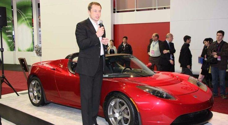 Tesla Motors' CEO Elon Musk alongside Roadster car