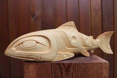 Salmon carved from yellow cedar by Erich Glendale. northwest coast art.