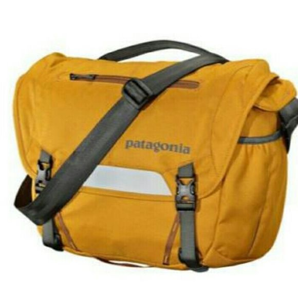 Patagonia MiniMass Messenger Bag in Amber Excellent condition bag I bought this fall. Very clean, very lightly used and looks brand new with the exception of a few Washer/Dryer marks. :) Love this bag, but I don't need any more! ***Available till April when I mass consign locally*** Patagonia Bags