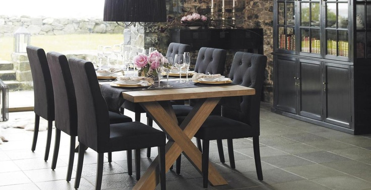 charcoal deep buttonedtufted dining chairs and pale rustic wood