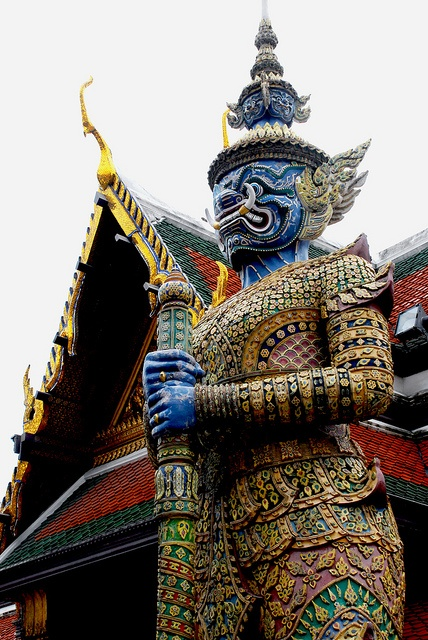 Thotsakhirithon, Bangkok - by Diego Rios    One of twelve giant demons (Yaksha), characters from the Thai Ramakian (or Ramayana) epic, guarding the south-western gate of Wat Phra Kaeo to the Grand Palace. It has a blue face with an elephant nose.    Photo by DiegoRios.com