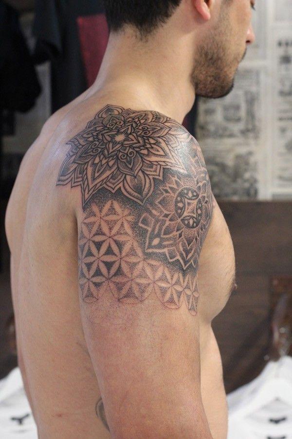 Artist: Woodfarm Tattoo Subject: Mandala with Flower of Life Tattoo Style: Dotwork, Blackwork, Geometric, Sacred Geometry Tags: Awesome, Placement, Shoulder  Cheltenham's prestigious tattoo studio TOKYOTATTOO