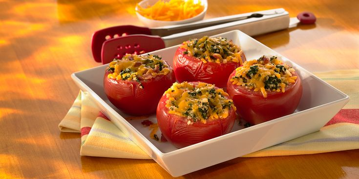 This stuffed tomato recipe is not only yummy but makes for good-looking finger food, too! Using Sargento® Shredded Sharp Cheddar Cheese - Traditional Cut, spinach and crispy bacon, create the incredible filling that we will use to fill these cute tomatoes that will be baked to perfection.