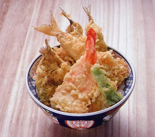 Tendon is a bowl of rice topped with tempura. It is poured with mildly sweet sauce (tare), which is usually made from dashi stock, mirin, soy sauce & sugar. Originally, tendon came from the menu of the famous tempura restaurant Sansada, in Asakusa, Tokyo. Although many kinds of tempura can be used for tendon; usually fish tempura, such as shrimp, squid, conger & sillaginoid are mixed with vegetable tempura, which includes green pepper, squash & sweet potato.